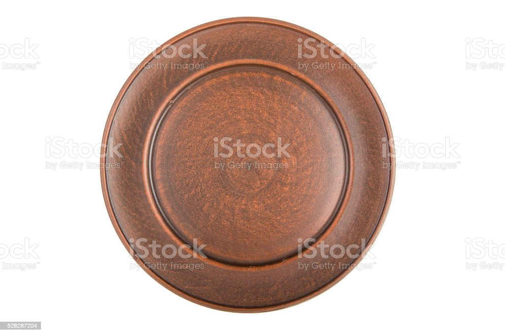 empty plate of red clay isolated stock photo