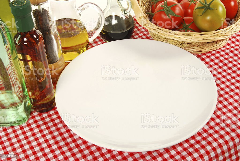Empty plate on bistro table royalty-free stock photo