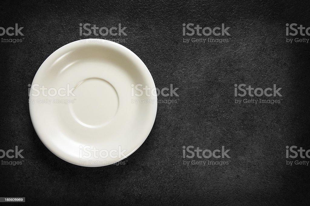 Empty plate on chalkboard black background royalty-free stock photo