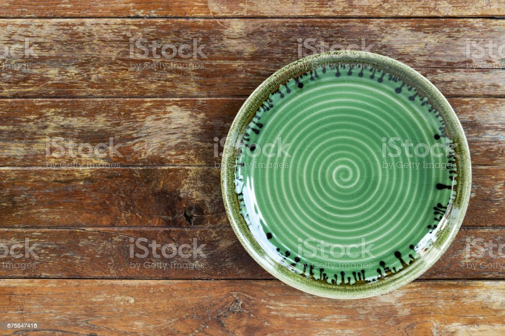 empty plate on wooden table stock photo