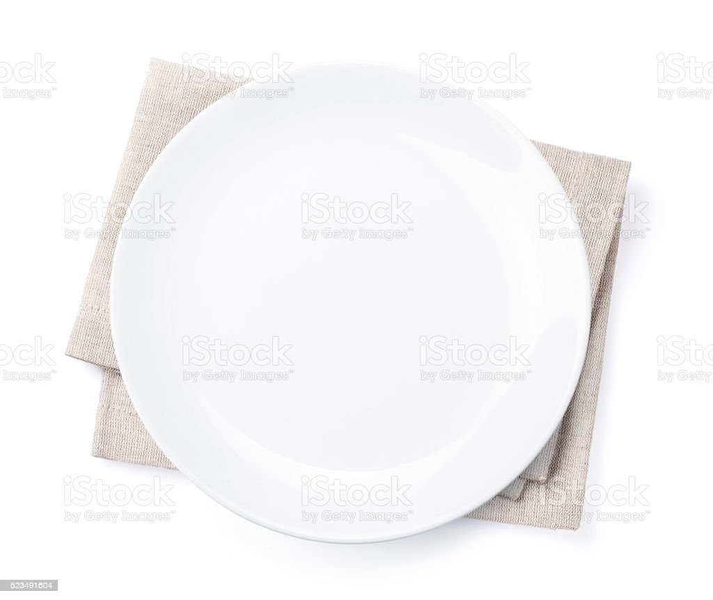 Empty plate over kitchen towel stock photo