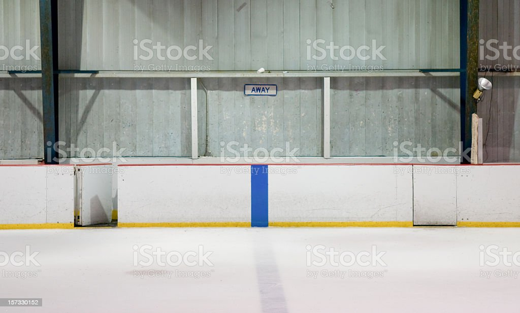 Empty player bench at a hockey arena stock photo