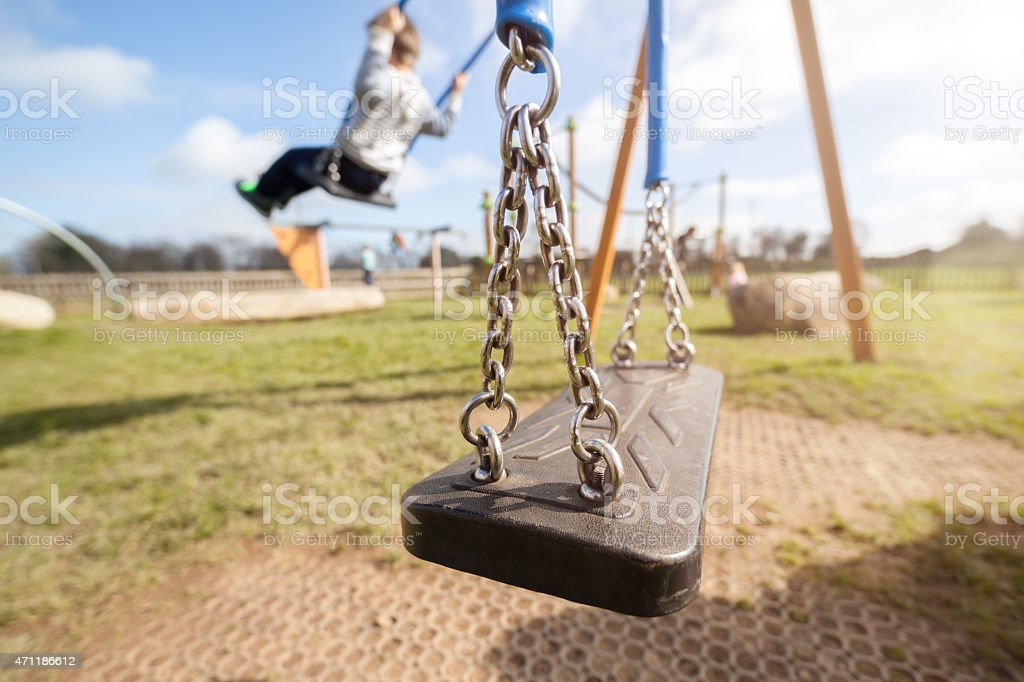 Empty playground swing stock photo
