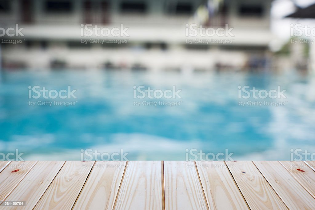 empty plywood and blur swimming pool background stock photo