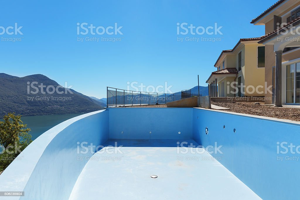 empty pool of houses stock photo