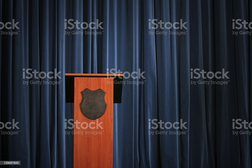 Empty press conference room with a wooden podium stock photo