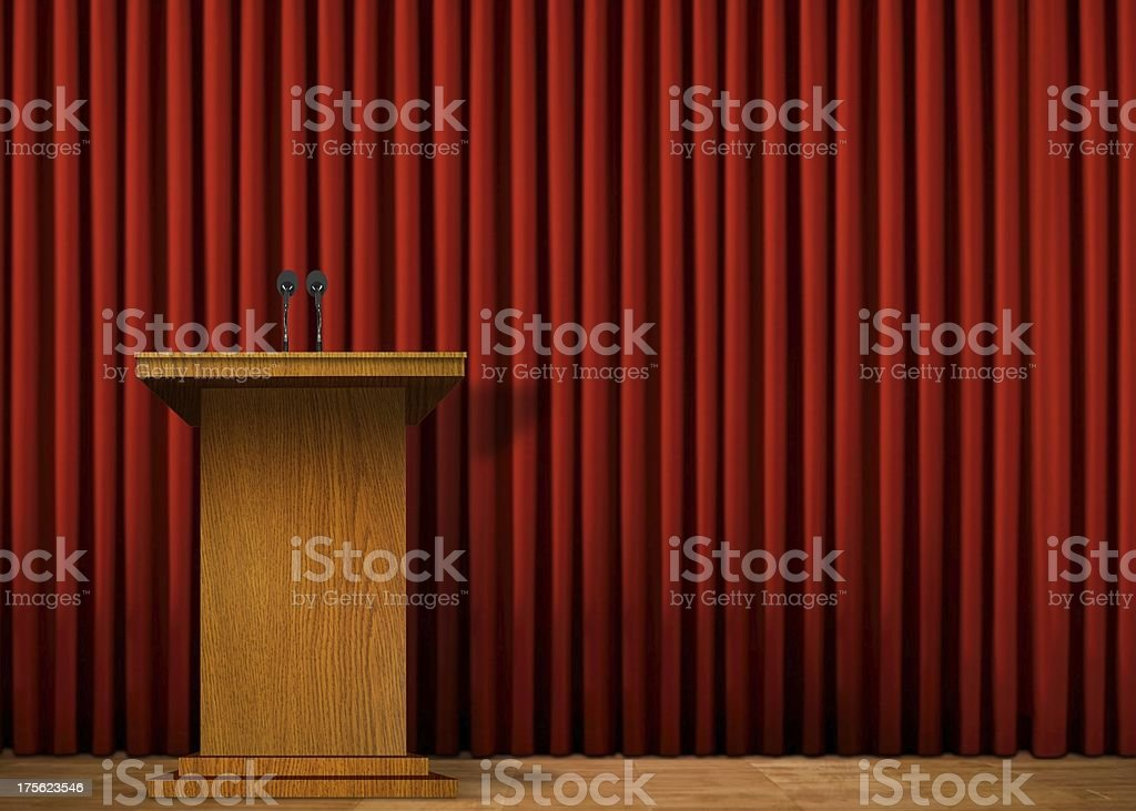 Empty press conference stage with podium and red curtain royalty-free stock photo