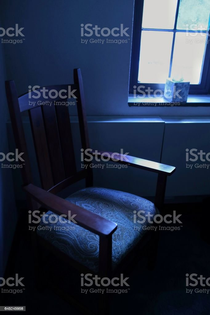 Empty Priest Chair, Purple Scarf, Confessional Reconciliation Booth stock photo