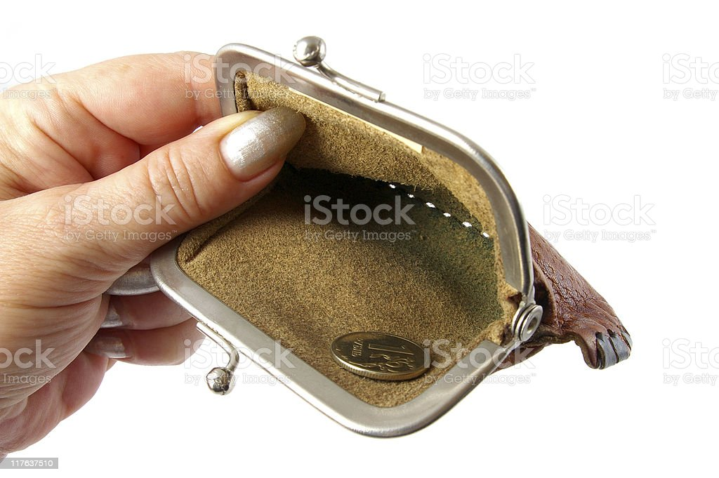 Empty purse in hand. royalty-free stock photo