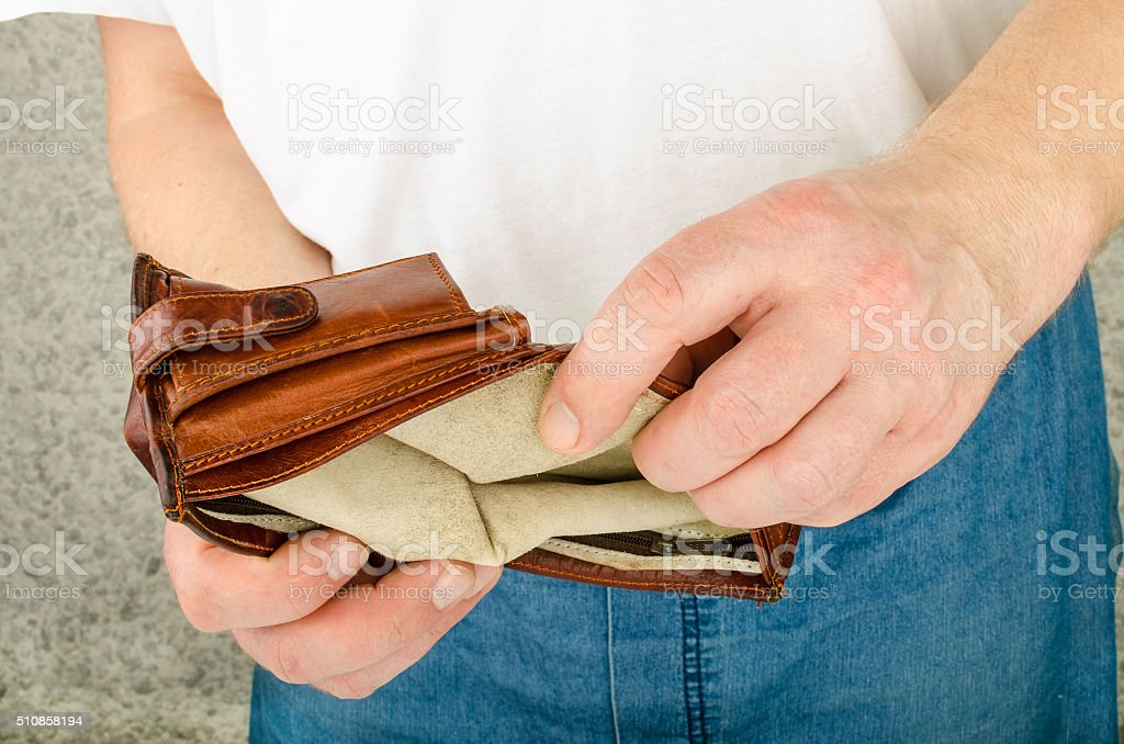 empty purse in his hands stock photo