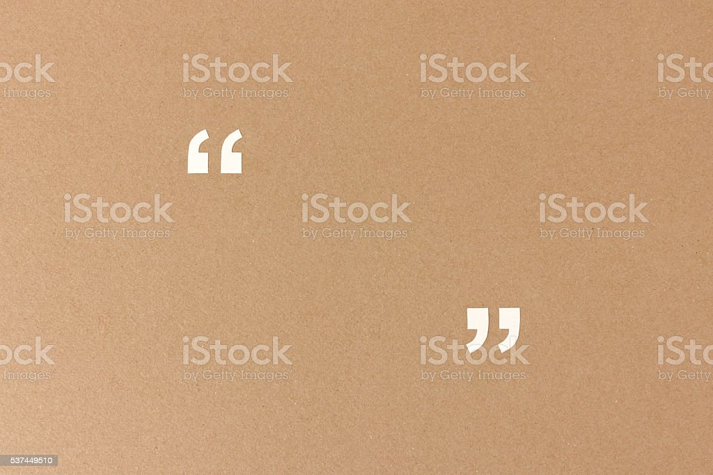 Empty quotation marks on recycling paper stock photo