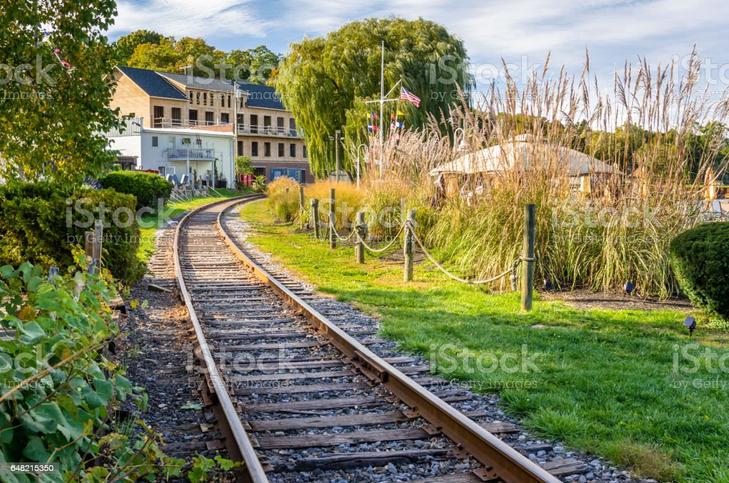 Empty Railroad Track through a Village stock photo