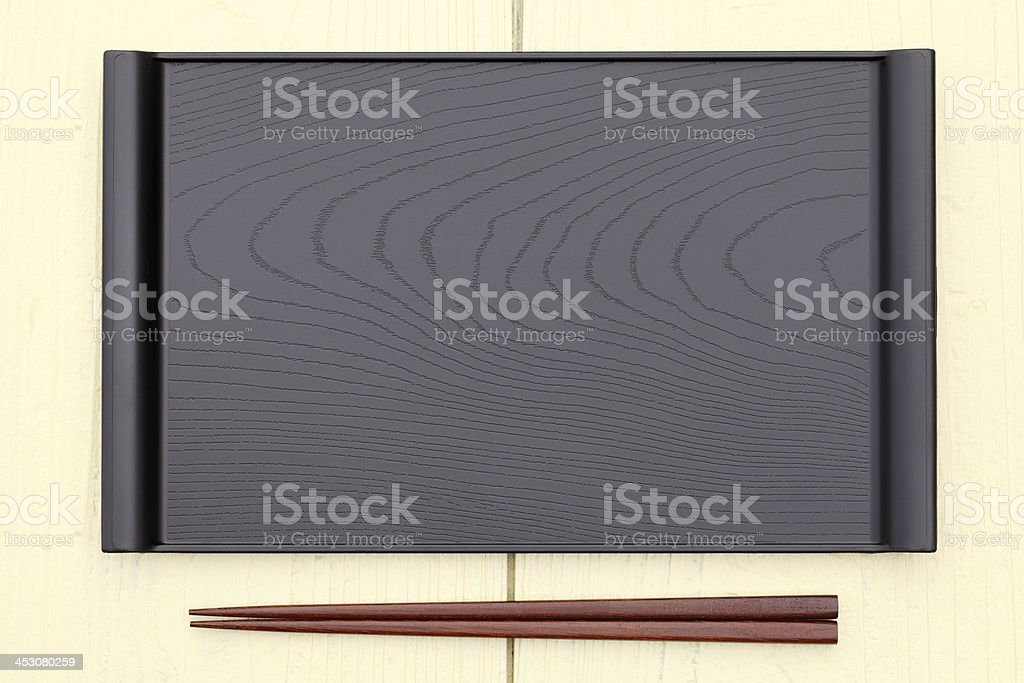 Empty rectangular plate with chopsticks in a wood table stock photo