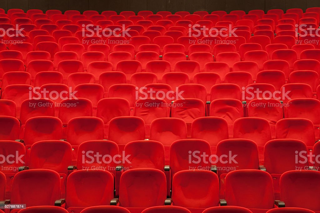 empty red cinema or theater seats stock photo