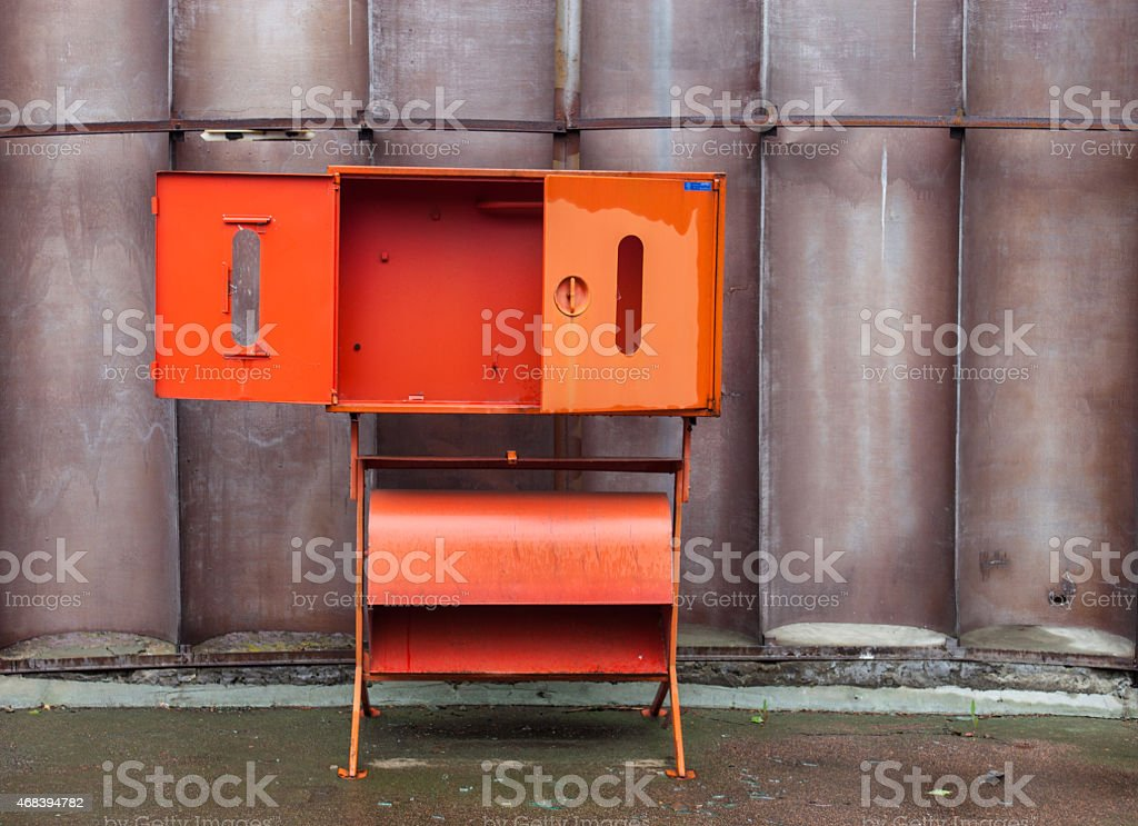 Empty red fire safety cabinet with the open door stock photo