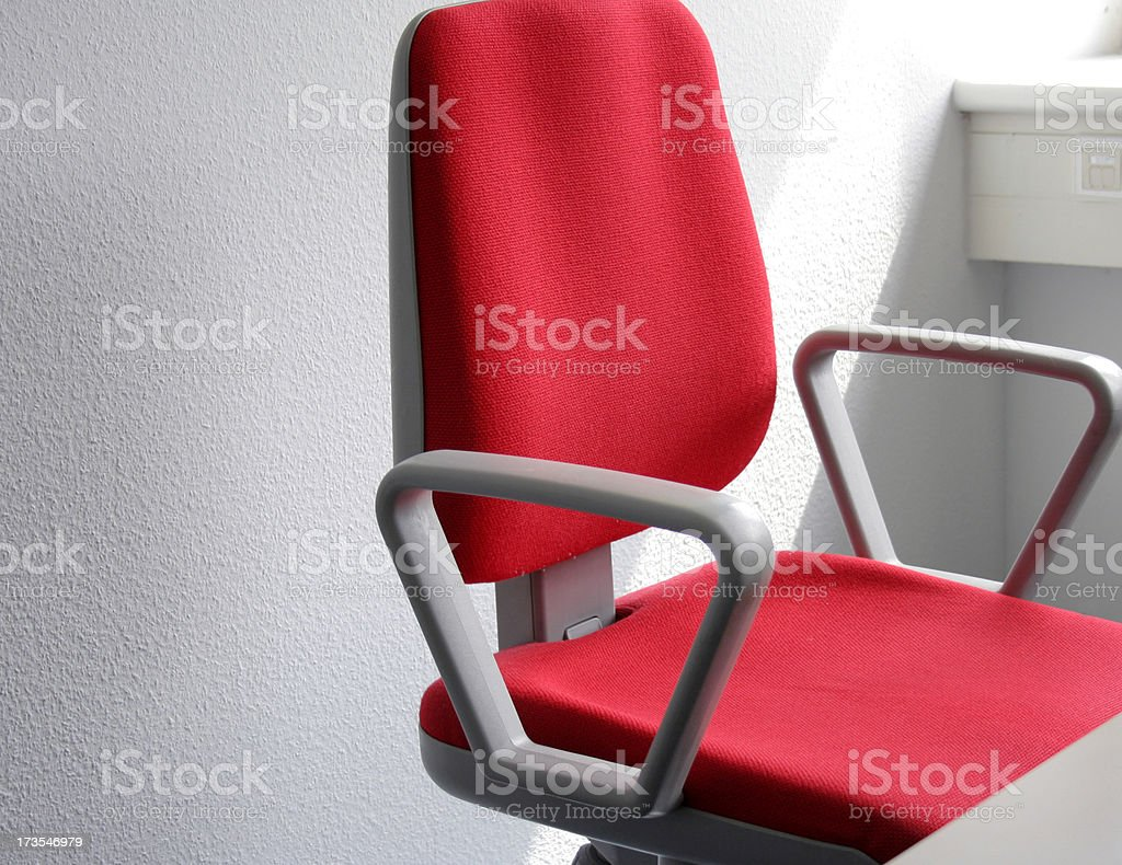 Empty red office chair in office close up stock photo