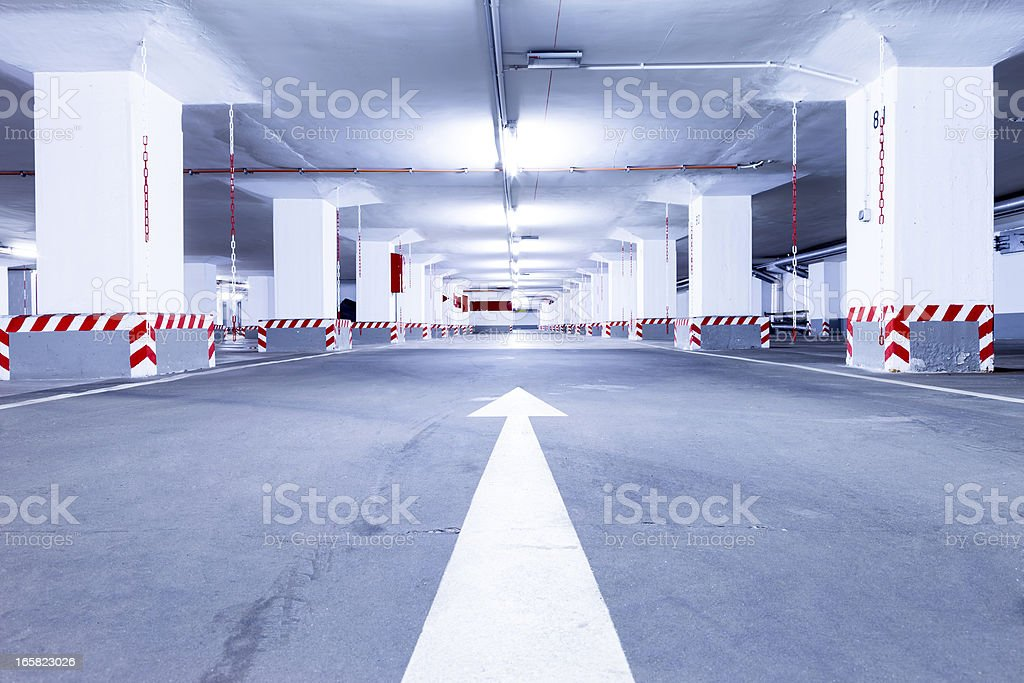 Empty red parking garage stock photo
