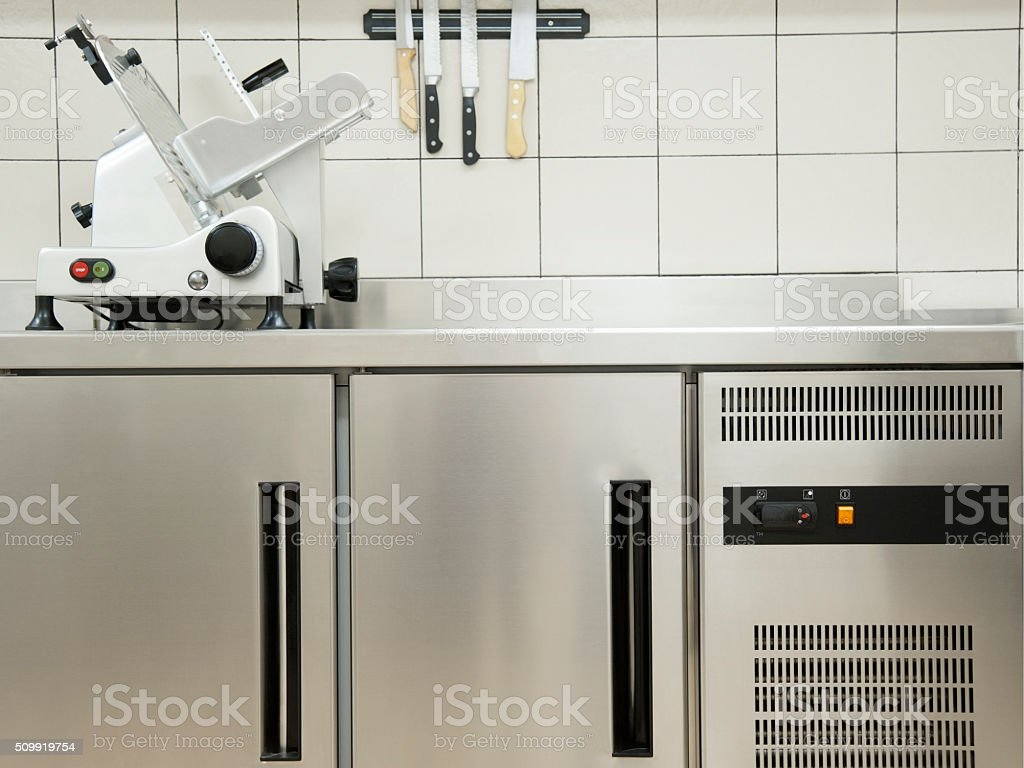 Empty restaurant kitchen with professional equipment a cutting m stock photo