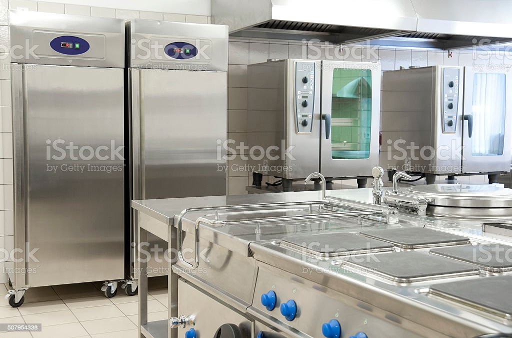 Empty restaurant kitchen with professional equipment stock photo