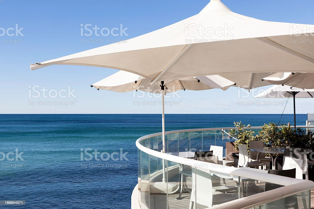 Empty restaurant overlooking the sea royalty-free stock photo