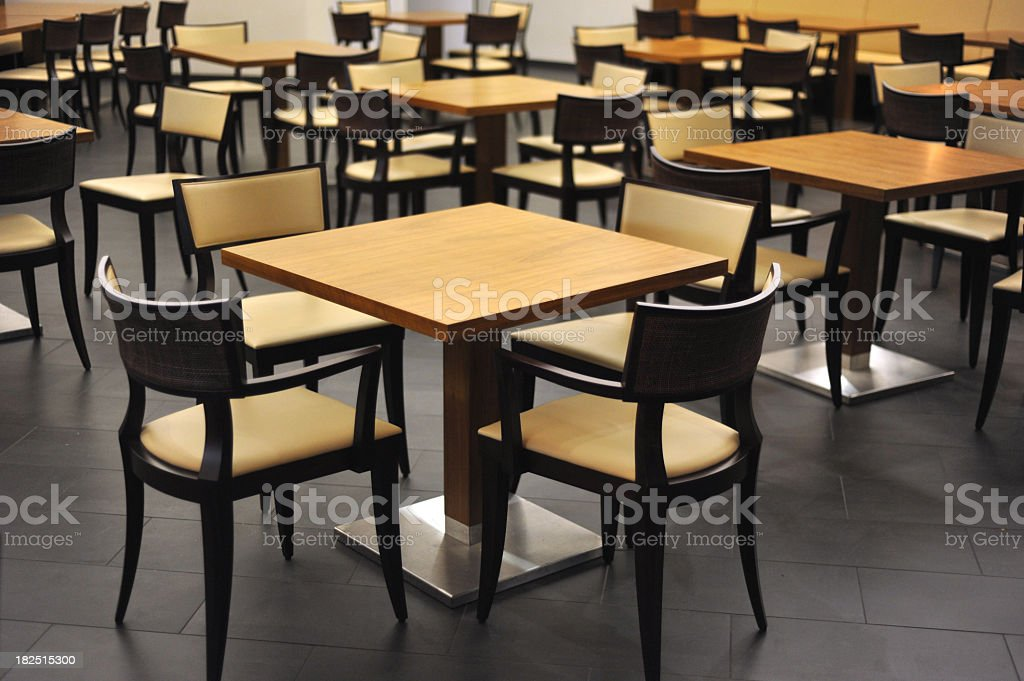 empty restaurant with tables and stools royalty-free stock photo