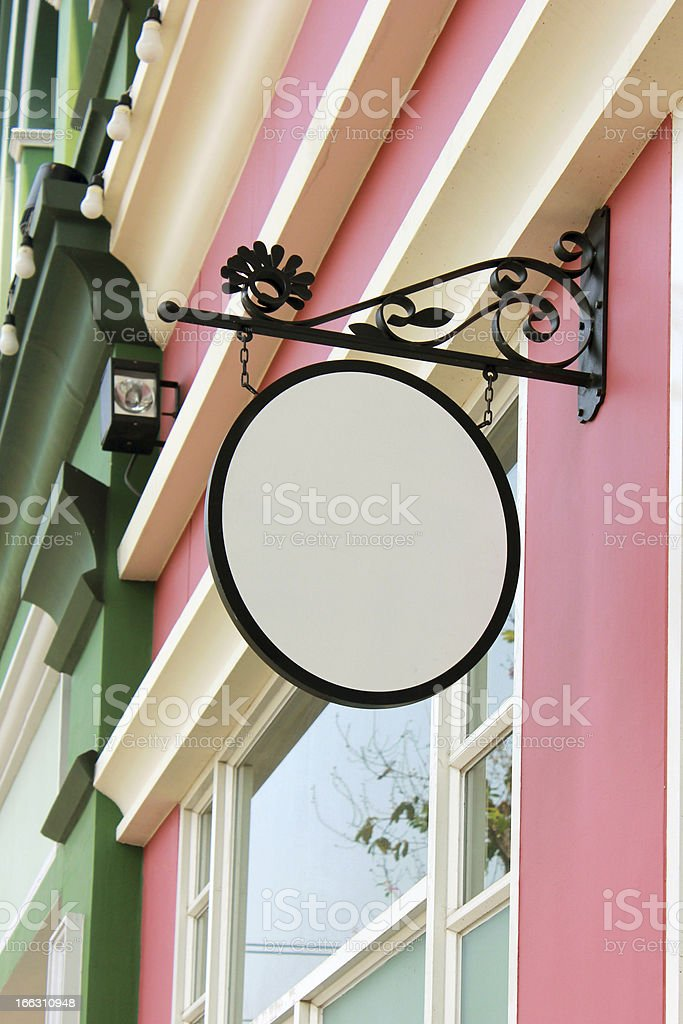 Empty retro signboard hanging on a house royalty-free stock photo