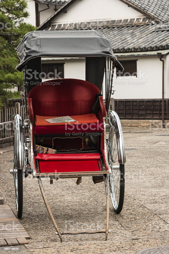 empty rickshaw parked on street stock photo