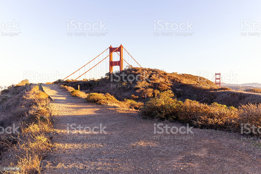 empty road by the sea and gold gate bridge stock photo