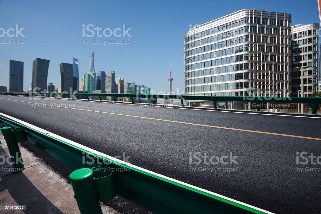 Empty road floor surface with modern city landmark buildings of Shanghai bund Skyline stock photo