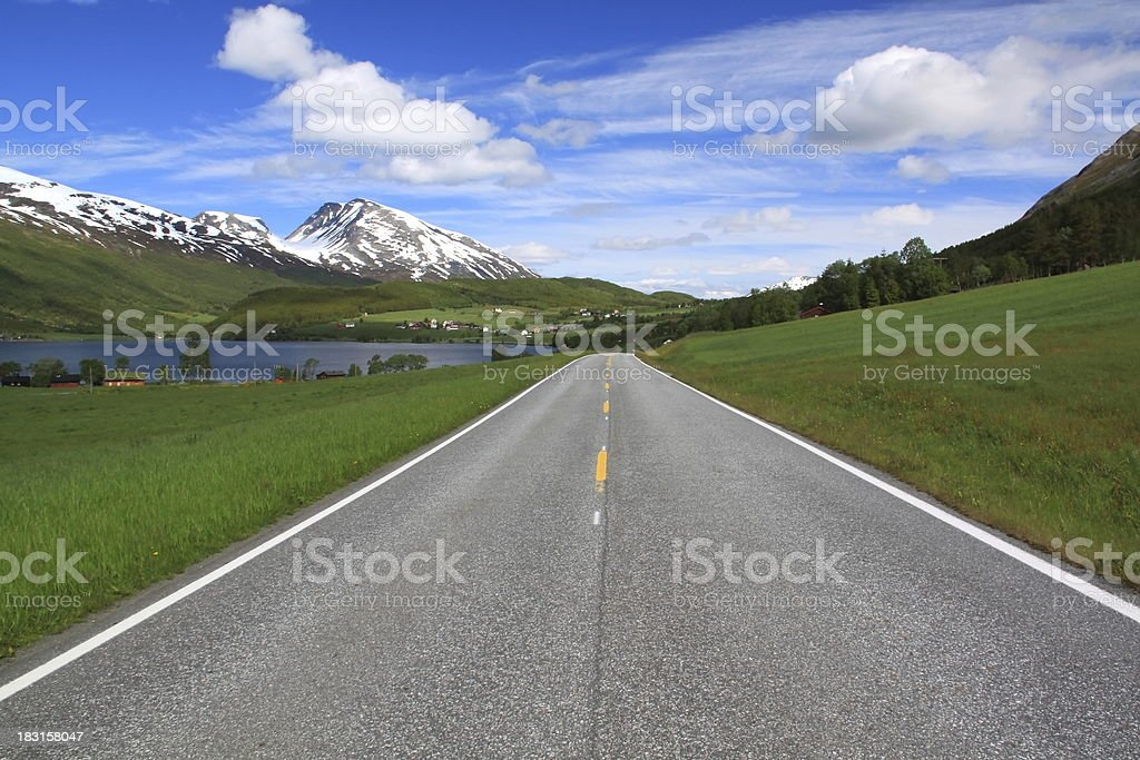 Empty Road in a idyllic green mountains countryside and clouds royalty-free stock photo