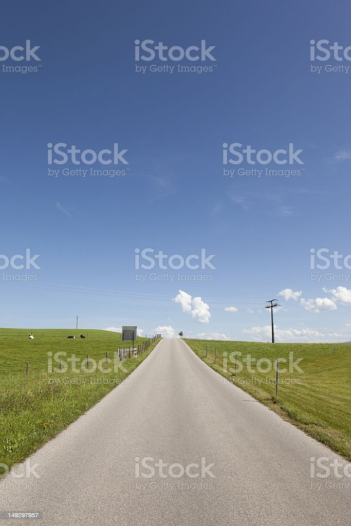 Empty road in a idyllic landscape stock photo
