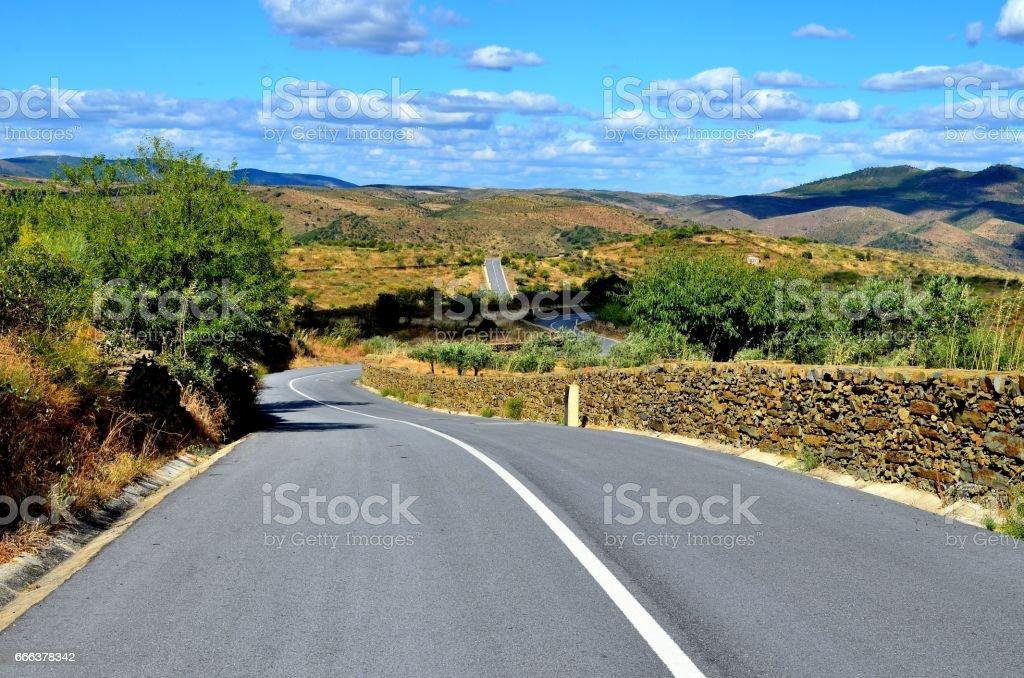 Empty road in a mediterranean landscape stock photo