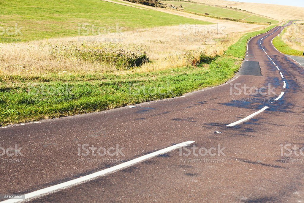 Empty road in the english countryside stock photo