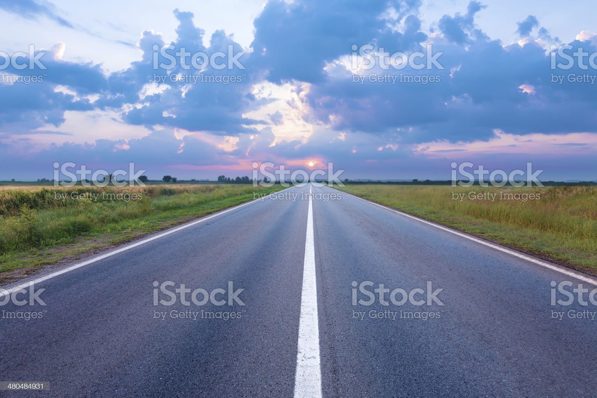 Empty road in the plain at dawn royalty-free stock photo