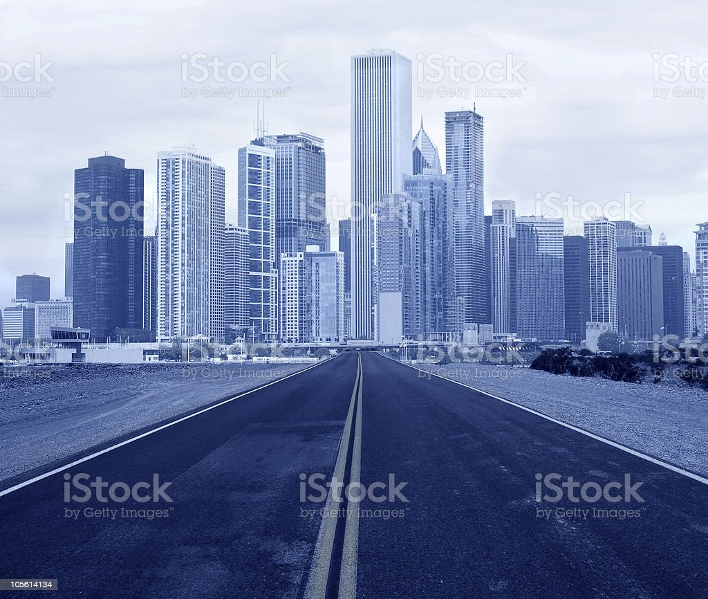 Empty road leading to a city royalty-free stock photo