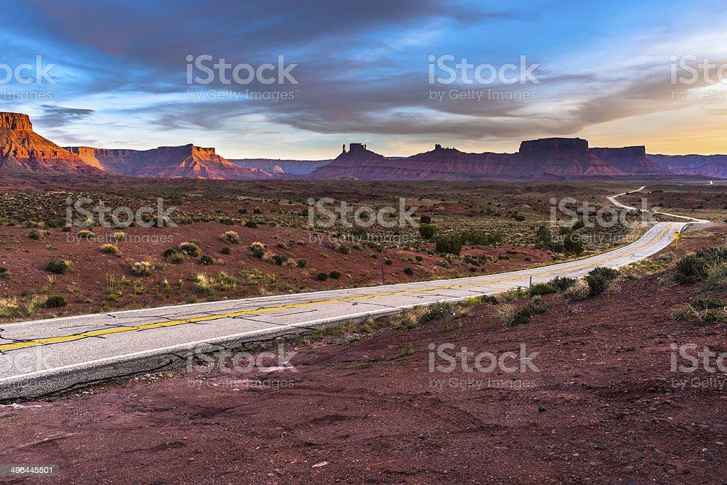 Empty road leading to Moab Utah - Castle Valle stock photo