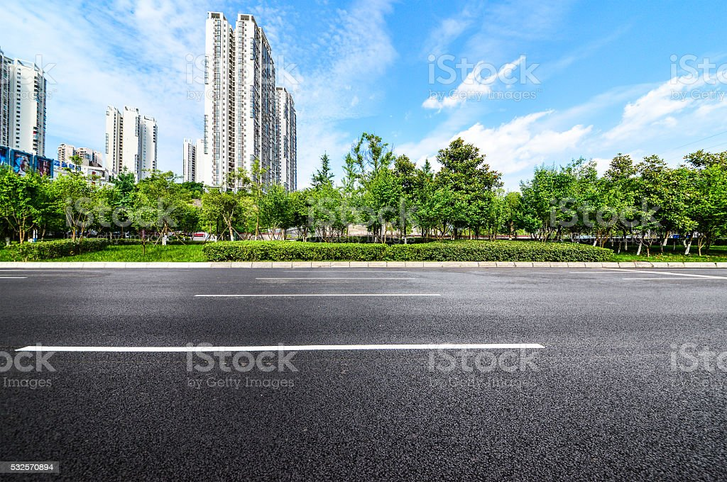empty road near modern building stock photo