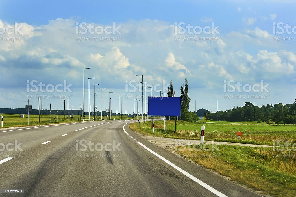 Empty road of Via Baltica E67 and beautiful clouds royalty-free stock photo