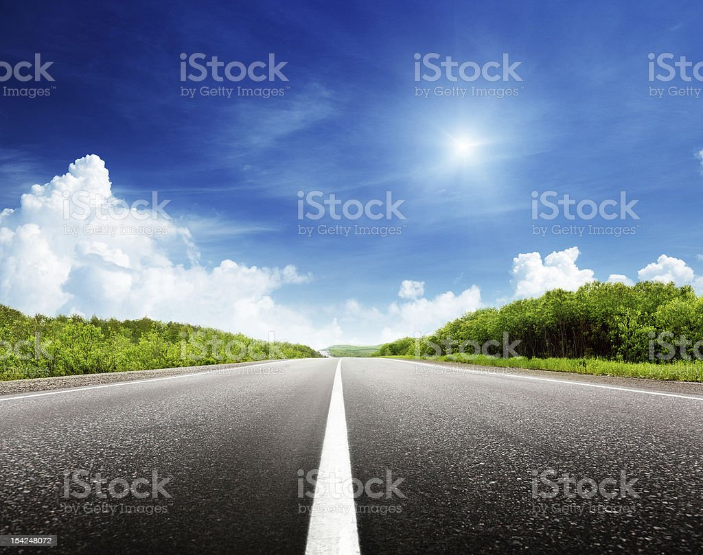A empty road on a clear summer day royalty-free stock photo