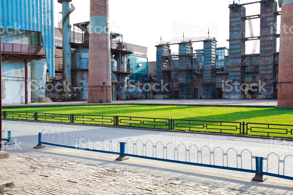 Empty road surface floor with old steel steelworks of pipelines stock photo