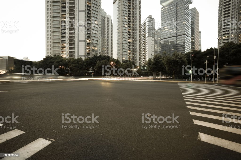 Empty road surface with city landmark buildings of evening stock photo