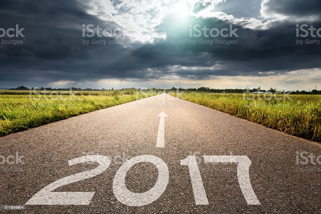 Empty road to upcoming 2017 against the big cloud stock photo