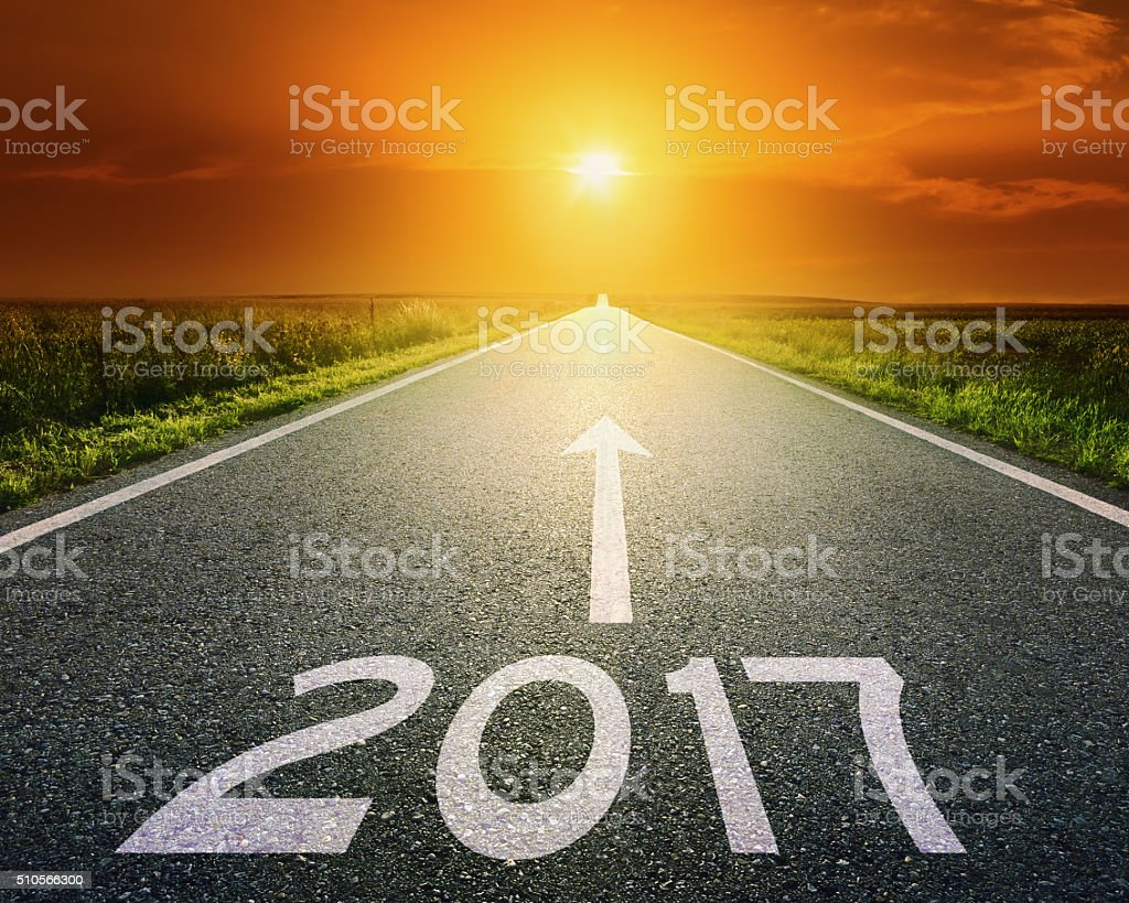 Empty road to upcoming 2017 at sunset stock photo