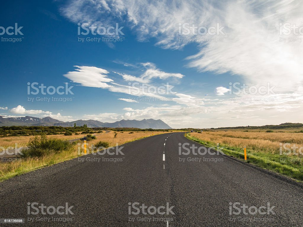 Empty road with a blue cloudy sky, Iceland stock photo