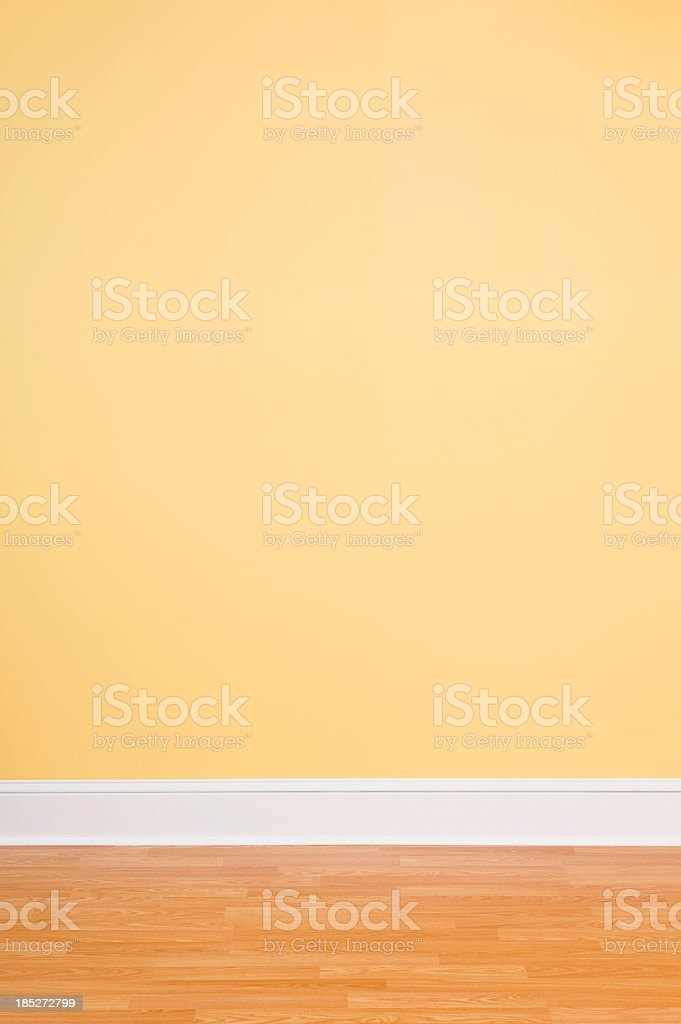 Empty room backdrop with yellow wall and wooden floor stock photo
