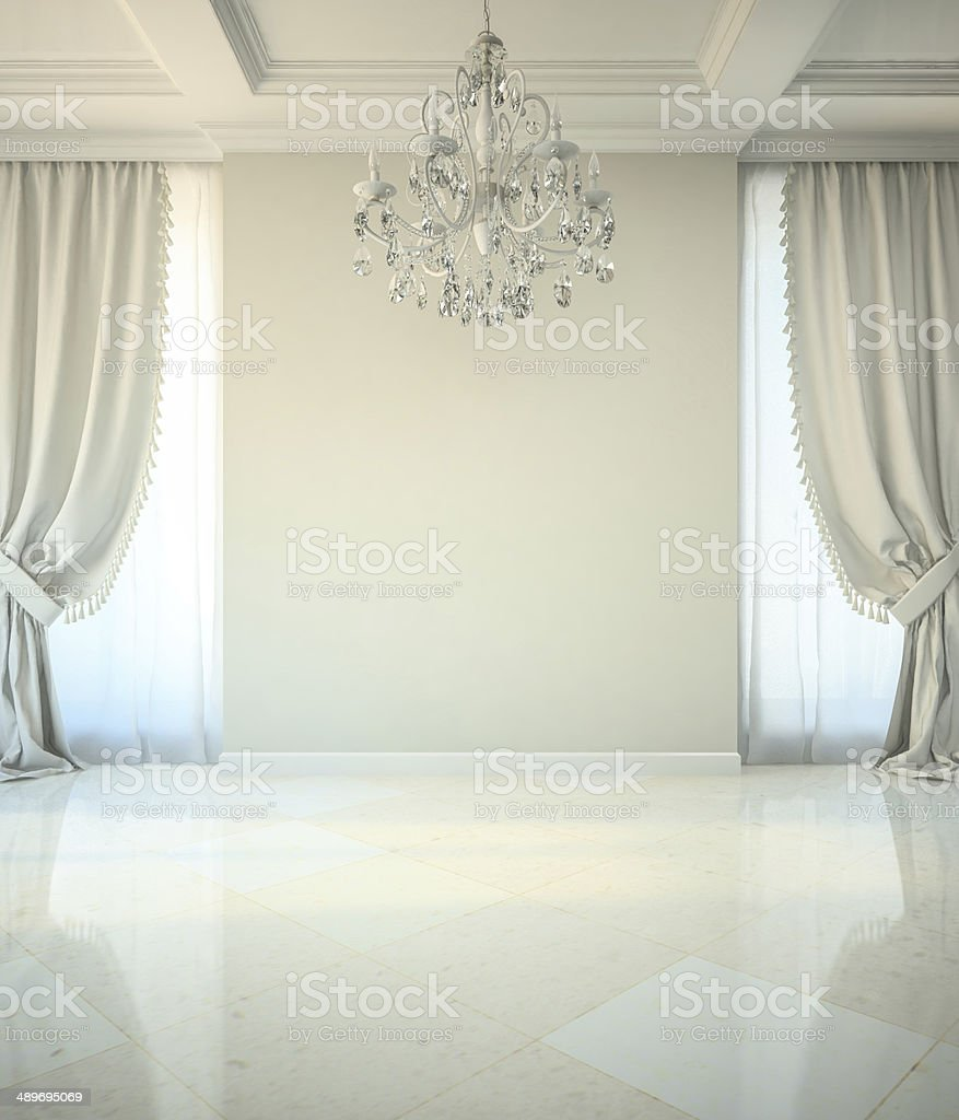 Empty room in classic style with crystal chandelier stock photo