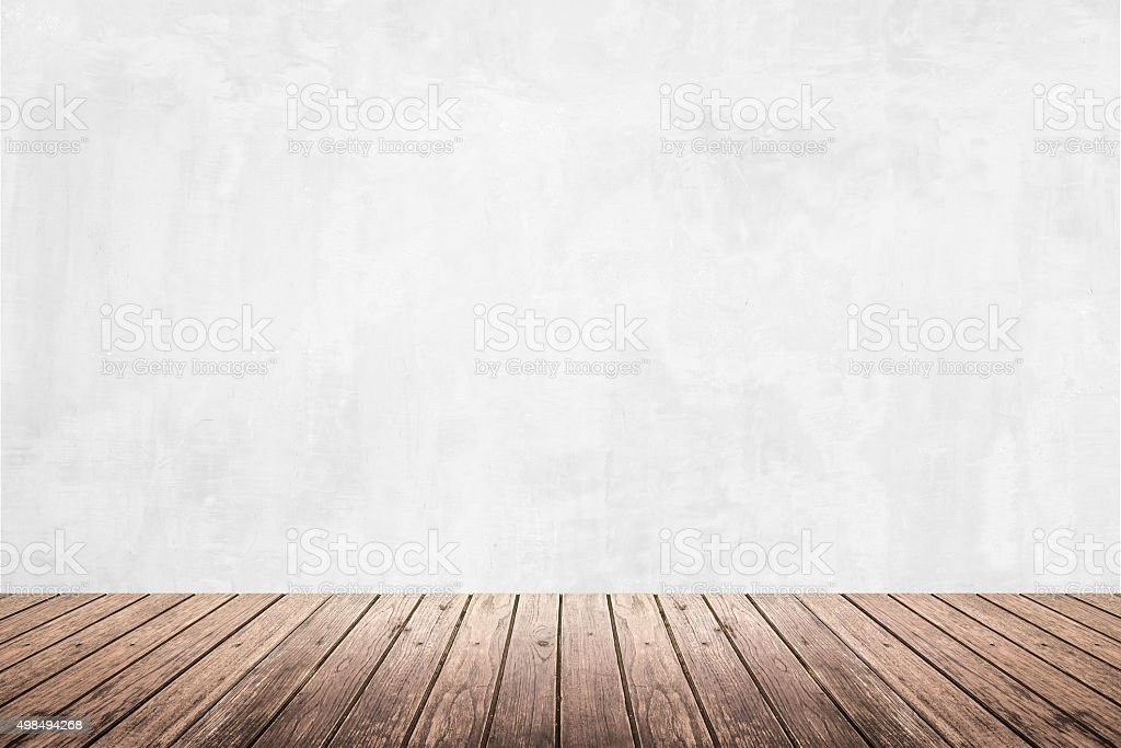 Empty room of grunge wall and wooden floor stock photo