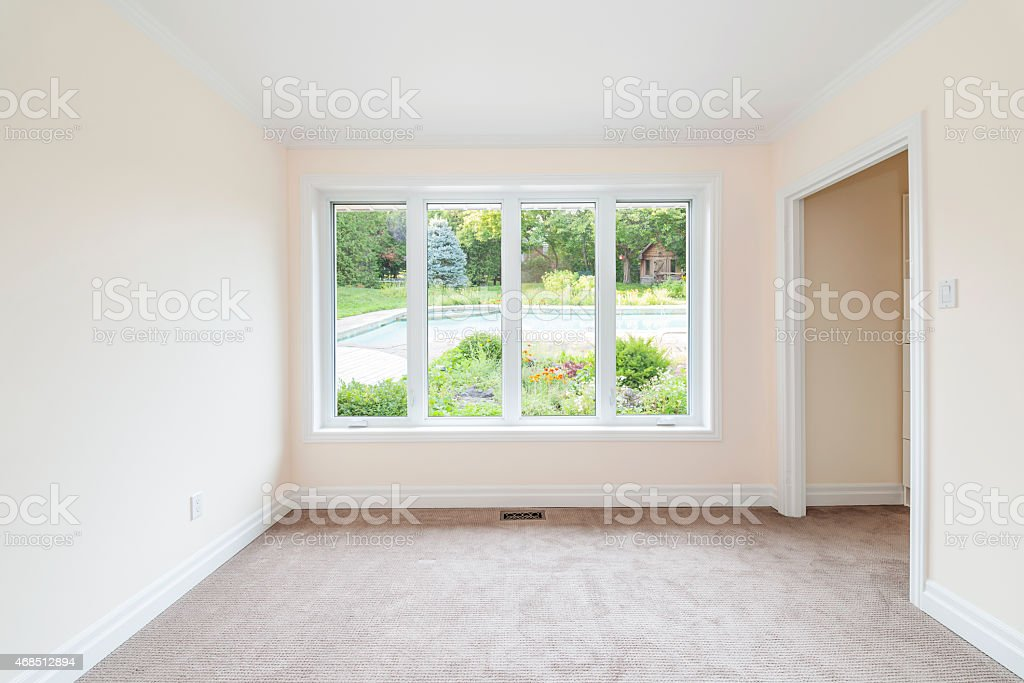 Empty room overlooking backyard stock photo