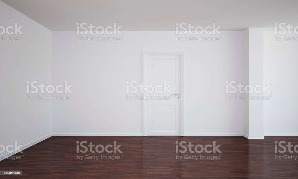 Empty room with a closed door and dark floor royalty-free stock photo