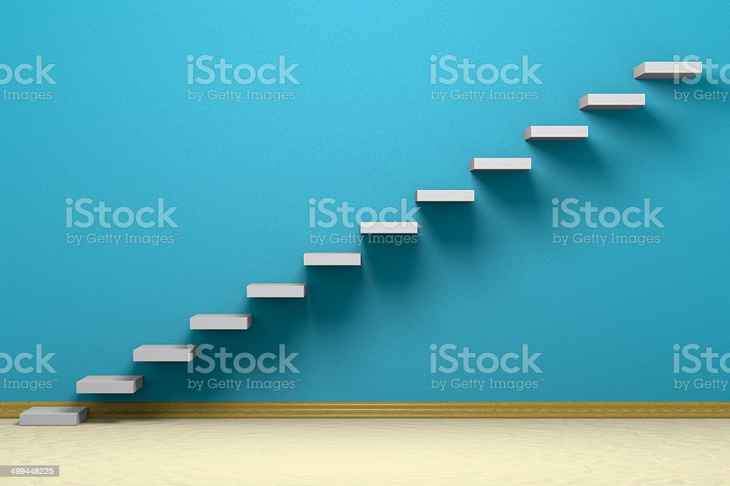 Empty room with ascending stairs stock photo
